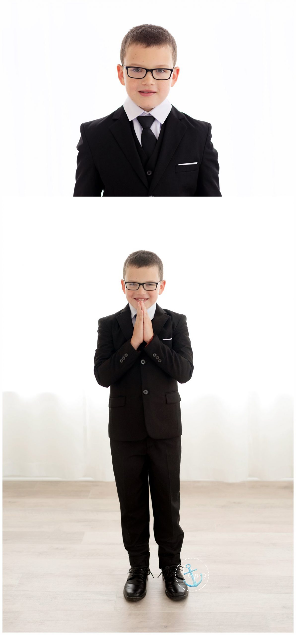 First Communion boy in black suit, photographed in a white, natural light studio. Copyright Cristina Elisa Photography LLC Frederick Maryland
