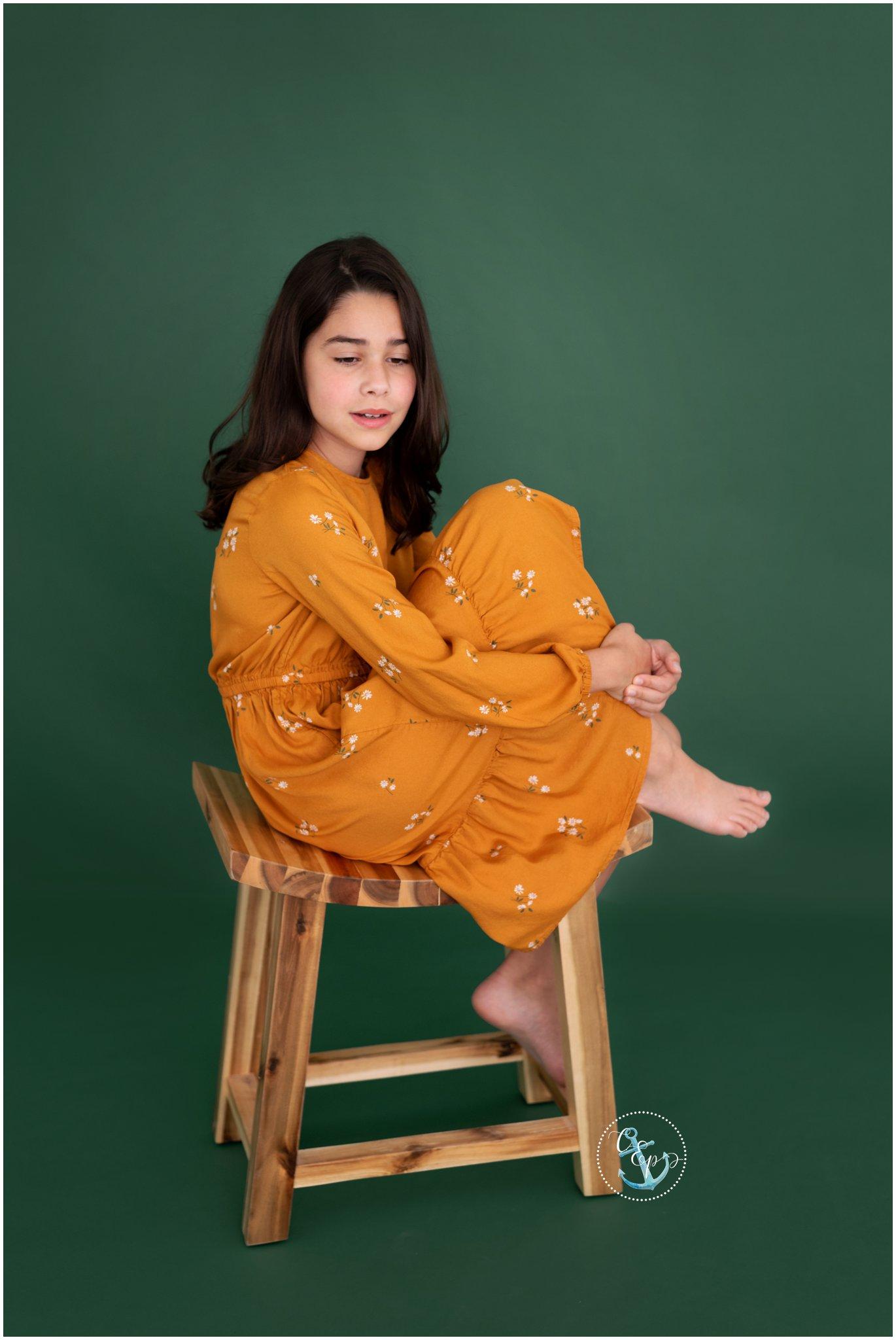 tween girl portrait on wooden stool, natural light studio photography in Frederick MD, children's portraits Maryland, Copyright Cristina Elisa Photography LLC